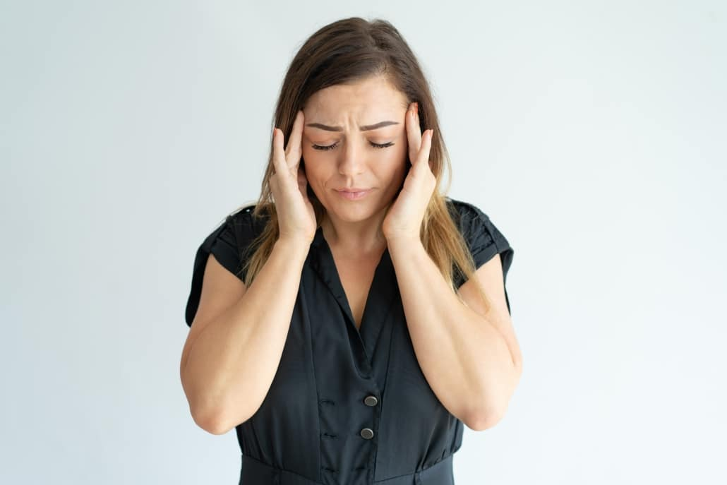 woman suffering from ocular migraines